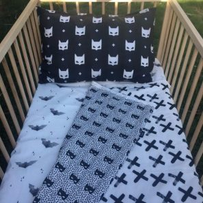Batman cot quilt set 2 min e1500871837957 297x297 - Black Cross Cot Quilt (Reversible with Batman Robyn Mask)